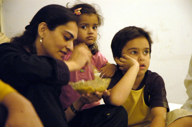 Risham Syed and her kids. Lahore. 2007. Photo by Akram Varraich